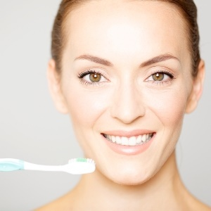 Beautiful woman holding a toothbrush