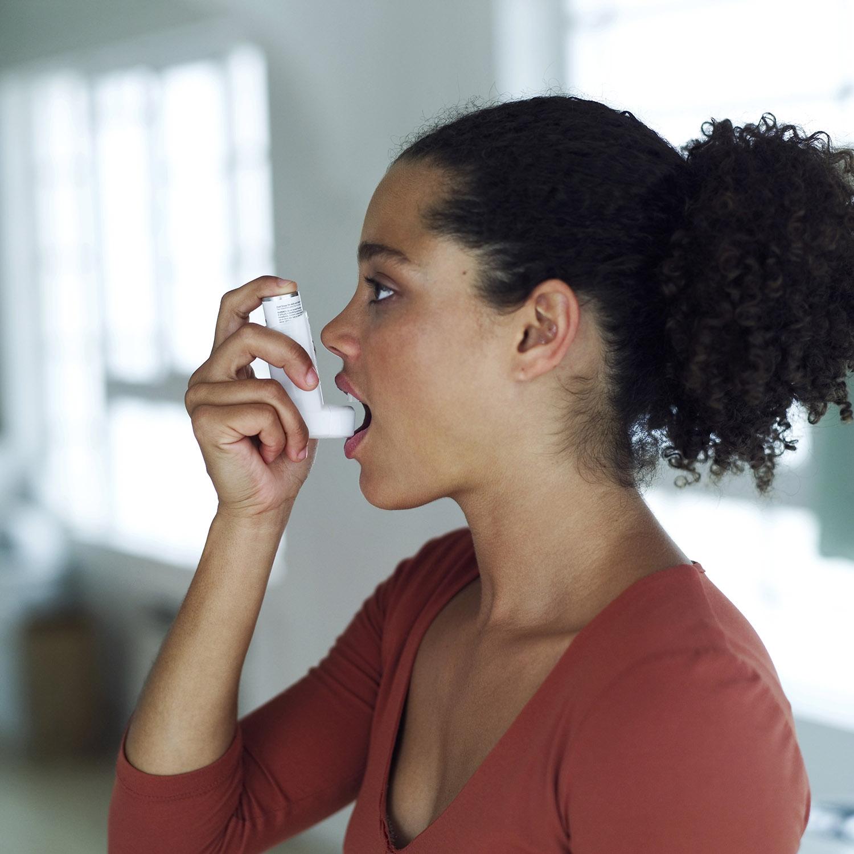 Young Woman (Using an Inhaler)
